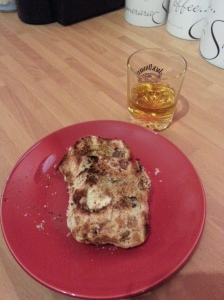 Toasted hot cross bun and a dram of whiskey