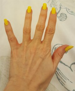 Yellow painted nails