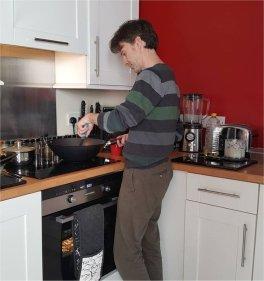 David cooking dinner